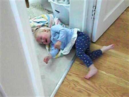 Toddler throwing a tantrum over frozen green beans.