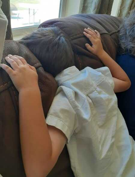 Young boy throwing a tantrum because he'd had enough of family scripture study.