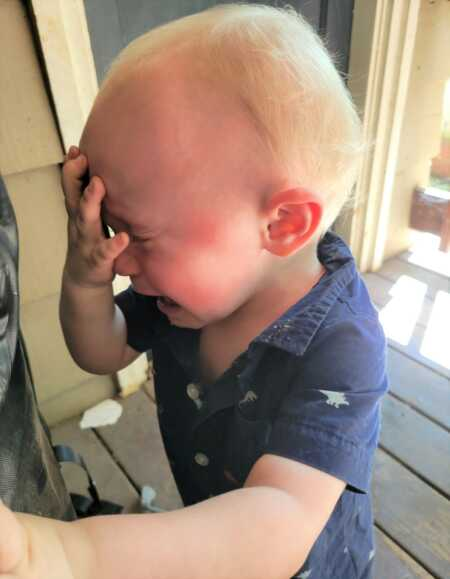 Toddler throwing a tantrum because he can't have coffee.