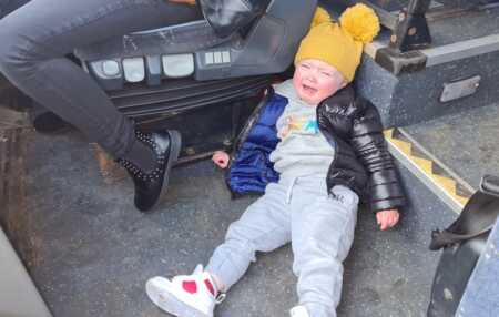 Toddler throwing a tantrum because they couldn't drive the bus.